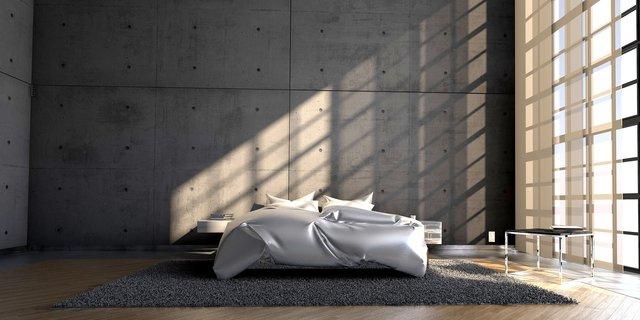 Salon z betonową ścianą